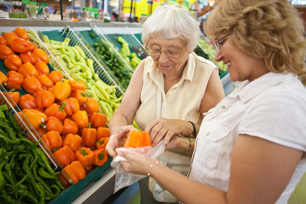 Senior Shopping Grocery Store with Caregiver